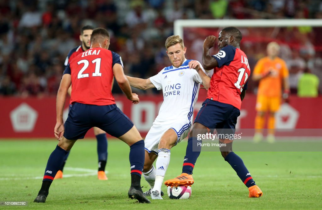 Callum Elder of Leicester City in action with Arton Zekaj and Jonathan Ikone of Lille during the pre-season friendly match between Lille and Leicester City at Stade Pierre Mauroy on August 4, 2018 in Lille, France.