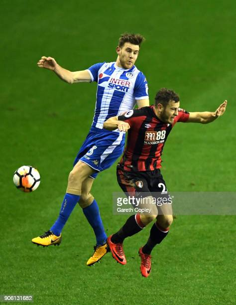 Callum Elder of Wigan Athletic and Connor Mahoney of AFC Bournemouth in action during The Emirates FA Cup Third Round Replay between Wigan and AFC...