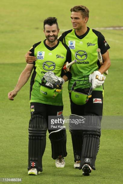 Callum Ferguson and Chris Green of the Thunder walk from the field after winning the Big Bash League match between the Perth Scorchers and the Sydney...