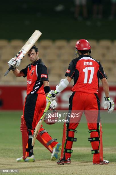 Callum Ferguson celebrates after scoring 100 runs during the Ryobi One Day Cup match between the South Australia Redbacks and the Western Australia...
