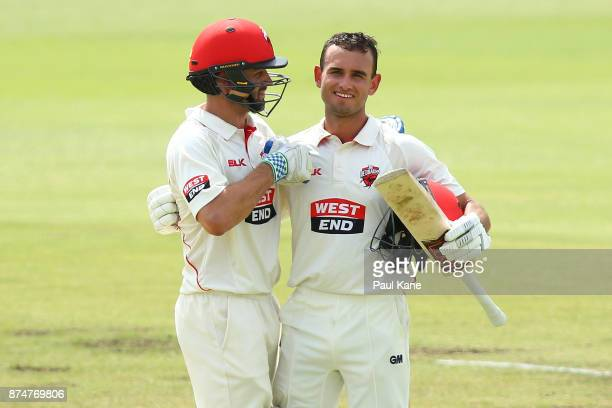 Callum Ferguson of South Australia congratulates Jake Weatherald of South Australia after scoring his century during day four of the Sheffield Shield...