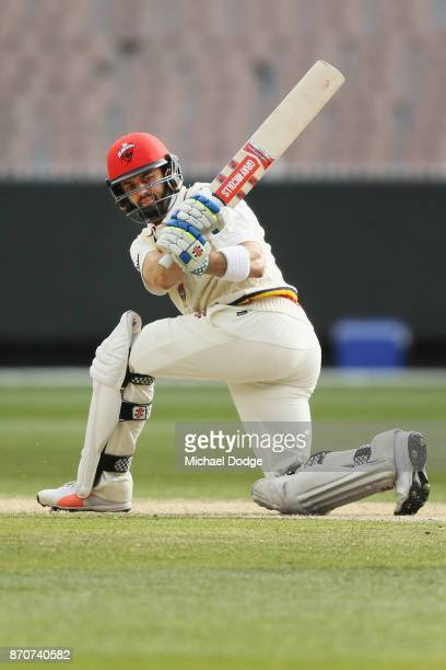 Callum Ferguson of South Australia sweeps the ball past Keeper Sam Harper of Victoria during day three of the Sheffield Shield match between Victoria...