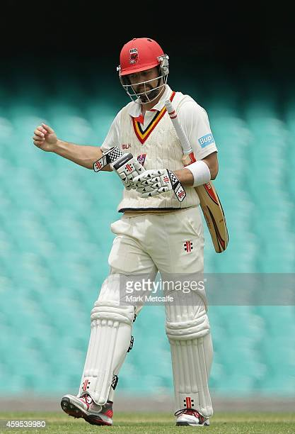 Callum Ferguson of South Australia walks from the field after being dismissed by Doug Bollinger of New South Wales during day one of the Sheffield...