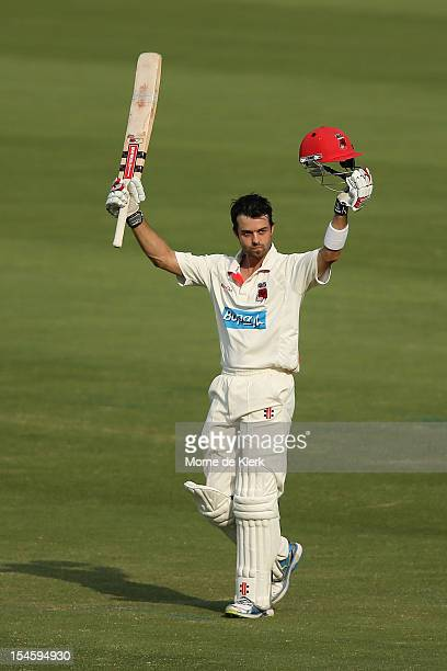 Callum Ferguson of the Redbacks celebrates after reaching 100 runs during day one of the Sheffield Shield match between the South Australian Redbacks...