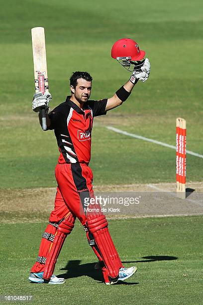 Callum Ferguson of the Redbacks celebrates after reaching 100 runs during the Ryobi One Cup Day match between the South Australian Redbacks and the...