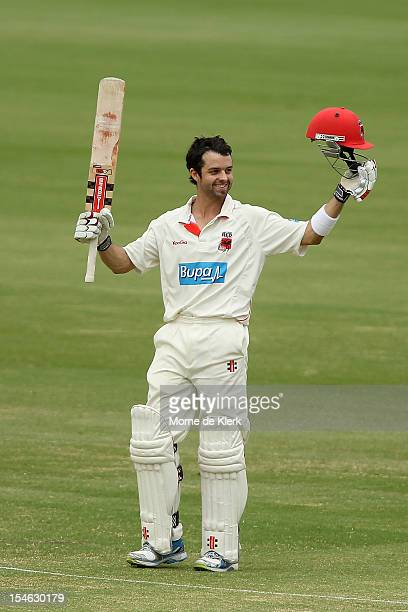 Callum Ferguson of the Redbacks celebrates after reaching 150 runs during day two of the Sheffield Shield match between the South Australian Redbacks...