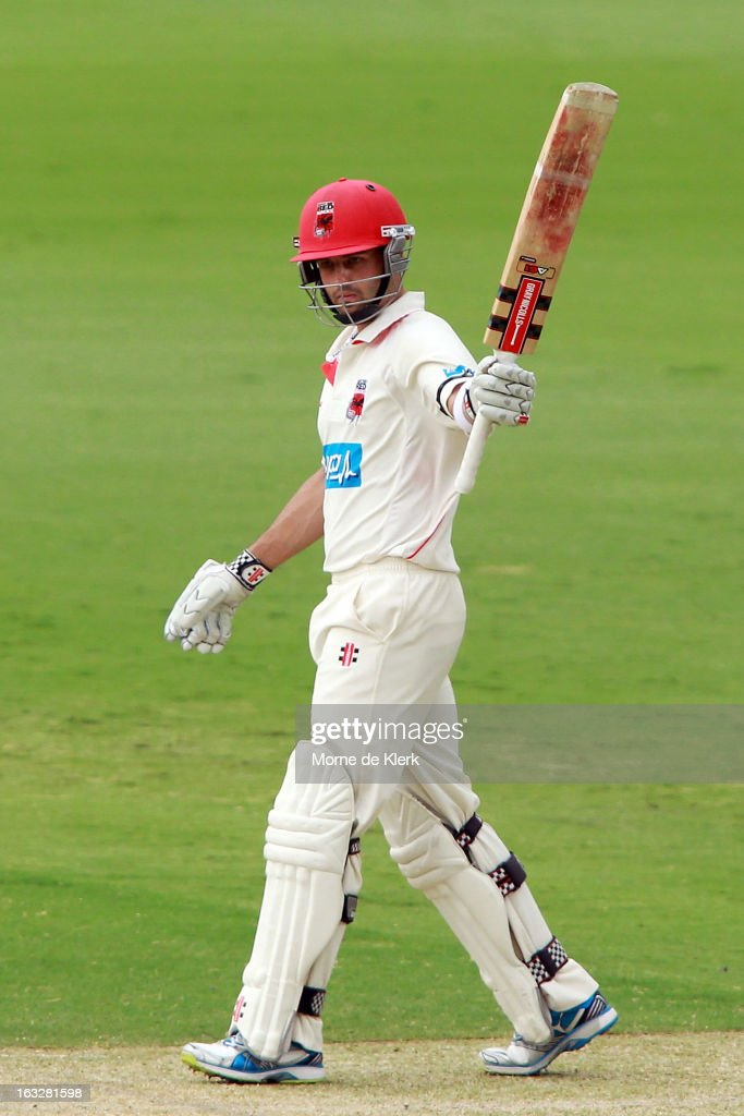 Callum Ferguson of the Redbacks celebrates after reaching 50 runs during day one of the Sheffield Shield match between the South Australian redbacks and the Western Australia Warriors at Adelaide Oval on March 7, 2013 in Adelaide, Australia.