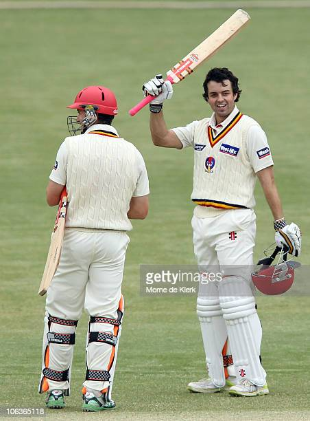 Callum Ferguson of the Redbacks celebrates making 100 runs during day two of the Sheffield Shield match between the South Australian Redbacks and the...