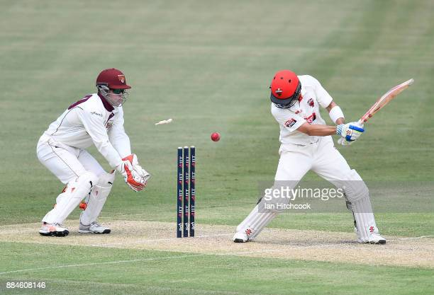 Callum Ferguson of the Redbacks is bowled out during day one of the Sheffield Shield match between Queensland and South Australia at Cazaly's Stadium...