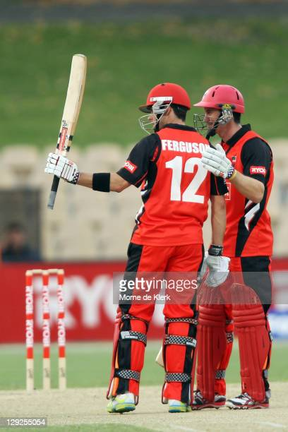 Callum Ferguson of the Redbacks is congratulated by his captain Michael Klinger after Ferguson scored 50 runs during the Ryobi One Day Cup match...
