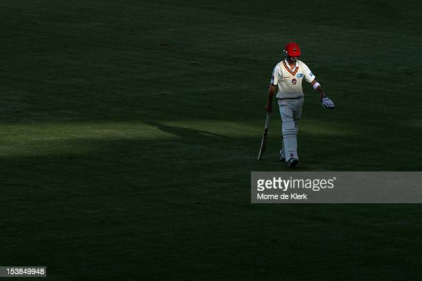 Callum Ferguson of the Redbacks leaves the field after getting out during day two of the Sheffield Shield match between South Australian Redbacks and...