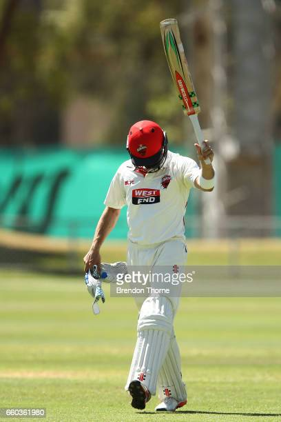 Callum Ferguson of the Redbacks walks back to the pavilion after being dismissed by James Pattinson of the Bushrangers during the Sheffield Shield...