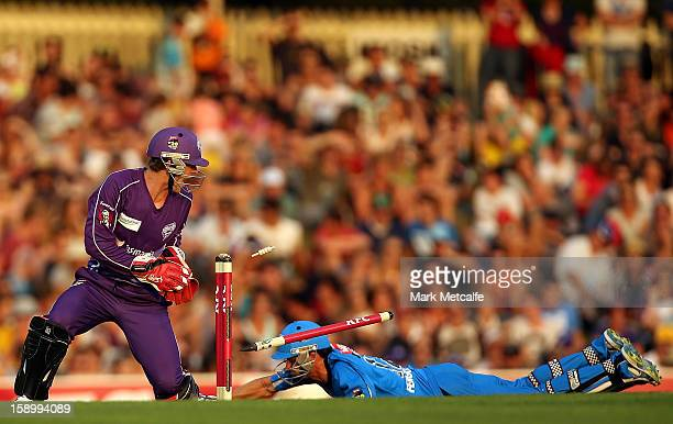 Callum Ferguson of the Strikers is run out by Owais Shah of the Hurricanes during the Big Bash League match between the Hobart Hurricanes and the...