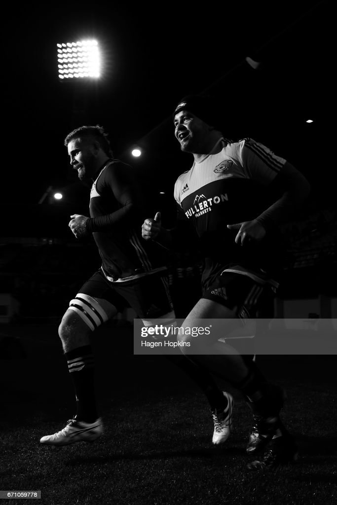 Callum Gibbins and Mike Kainga of the Hurricanes take the field to warm up during the round nine Super Rugby match between the Hurricanes and the Brumbies at McLean Park on April 21, 2017 in Napier, New Zealand.