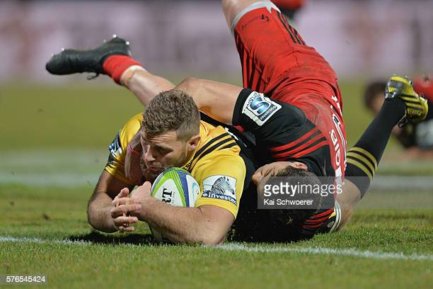 Callum Gibbins of the Hurricanes dives over to score a try during the round 17 Super Rugby match between the Crusaders and the Hurricanes at AMI...
