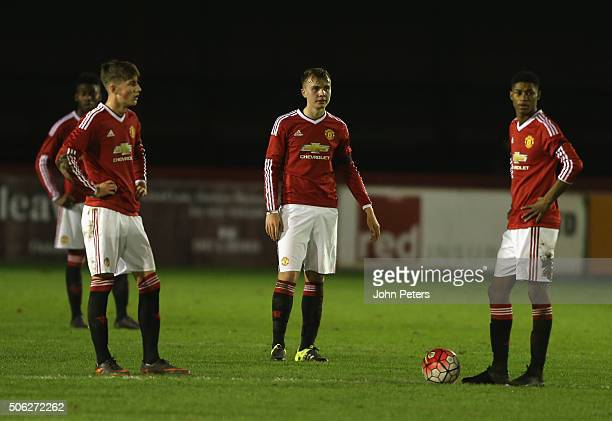 Callum Gribbin Charlie Scott and Marcus Rashford of Manchester United U18s react to conceding the opening goal during the FA Youth Cup fourth round...