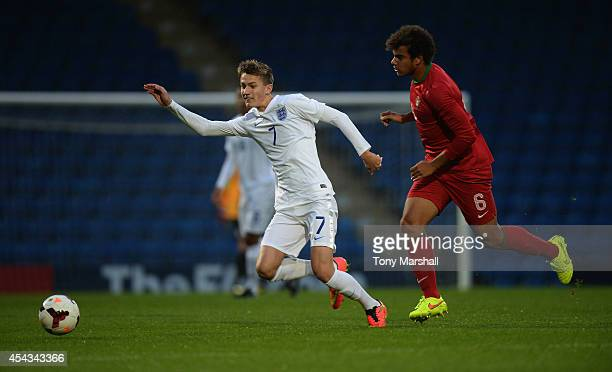 Callum Gribbin of England is tackled by Pedro Ferreira of Portugal during the Under 17 International match between England U17 and Portugal U17 at...