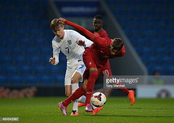 Callum Gribbin of England tackles Ricardo Mangas of Portugal during the Under 17 International match between England U17 and Portugal U17 at Proact...