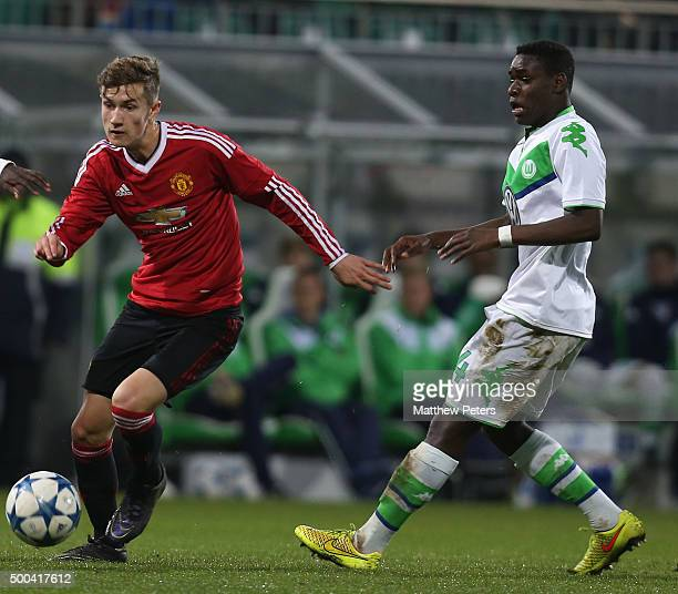 Callum Gribbin of Manchester United U19s in action with Iba May of VfL Wolfsburg U19s during the UEFA Youth League match between VfL Wolfsburg U19s...