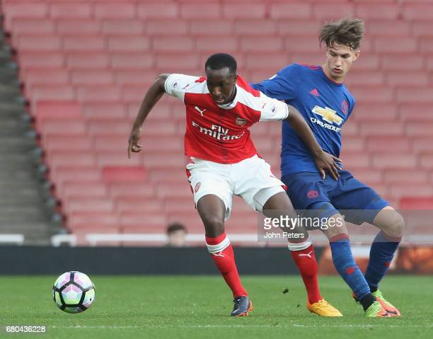 Callum Gribbin of Manchester United U23s in action with Eddie Nketiah of Arsenal U23s during the Premier League 2 match between Arsenal U23s and...