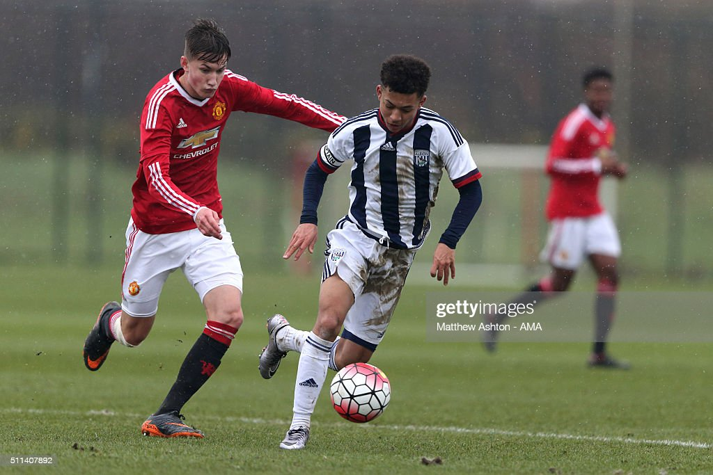 Callum Gribbon of Manchester United U18 and Chay Scrivens of West Bromwich Albion U18 during the U18 Premier League match between Manchester United and West Bromwich Albion at Aon Training Complex on February 20, 2016 in Manchester, England.