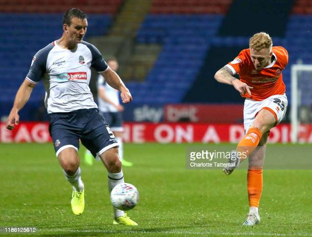 Callum Guy of Blackpool FC shoots during the Sky Bet Leauge One match between Bolton Wanderers and Blackpool at University of Bolton Stadium on...