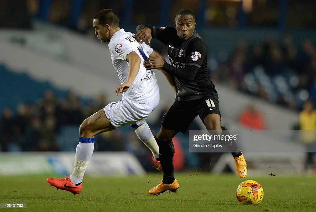 Callum Harriott of Charlton Athletic gets past Giuseppe Bellusci of Leeds United during the Sky Bet Championship match between Leeds United and Charlton Athletic at Elland Road on November 4, 2014 in Leeds, England.