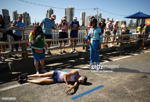 Callum Hawkins of Scotland collapses as he competes in the Men's marathon on day 11 of the Gold Coast 2018 Commonwealth Games at Southport Broadwater...