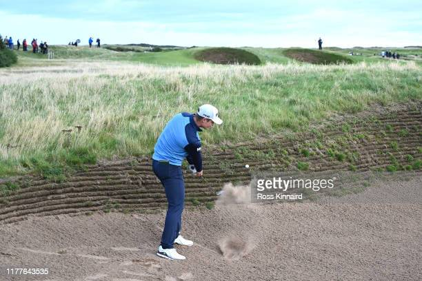 Callum Hill of Scotland plays their second shot on the 14th hole during Day three of the Alfred Dunhill Links Championship at Carnoustie Golf Links...