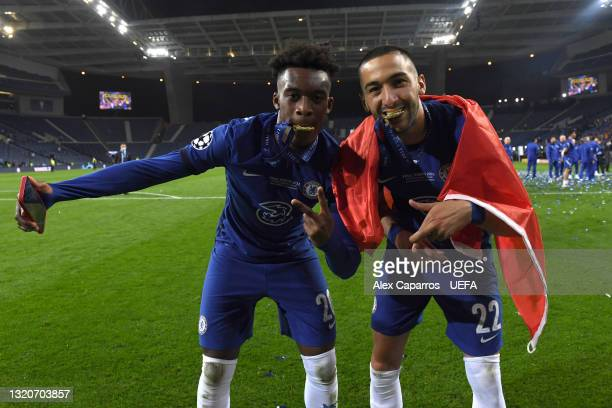 Callum Hudson-Odoi and Hakim Ziyech of Chelsea celebrate with their Champions League winners medals following victory in the UEFA Champions League...