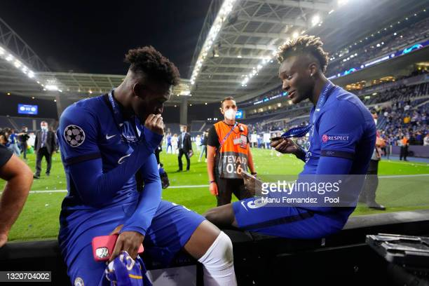 Callum Hudson-Odoi and Tammy Abraham of Chelsea hold their winners medals following their side's victory in the UEFA Champions League Final between...