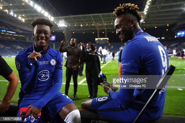 Callum Hudson-Odoi and Tammy Abraham of Chelsea smile following victory during the UEFA Champions League Final between Manchester City and Chelsea FC...