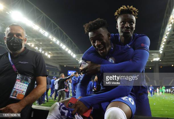 Callum Hudson-Odoi and Tammy Abrahams of Chelsea [right] celebrate after winning the UEFA Champions League Final against Manchester City at Estadio...