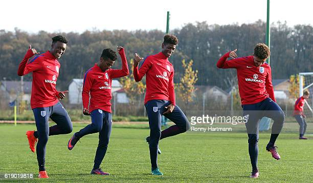 Callum HudsonOdoi Angel Gomes Jonathan Panzo and Jadon Sancho of England dance during the U17 England Training Session at Football Centre FRF on...