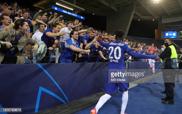 Callum Hudson-Odoi celebrates with the travelling Chelsea fans after winning the UEFA Champions League Final against Manchester City at Estadio do...