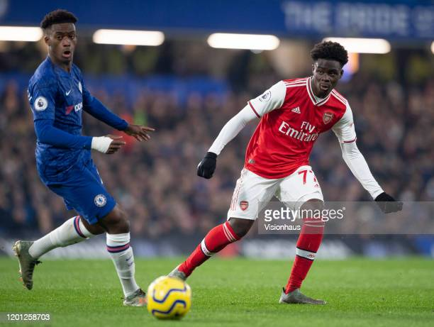 Callum HudsonOdoi of Chelsea and Bukayo Saka of Arsenal during the Premier League match between Chelsea FC and Arsenal FC at Stamford Bridge on...