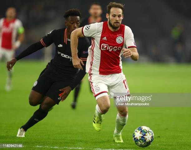 Callum HudsonOdoi of Chelsea battles for possession with Daley Blind of AFC Ajax during the UEFA Champions League group H match between AFC Ajax and...
