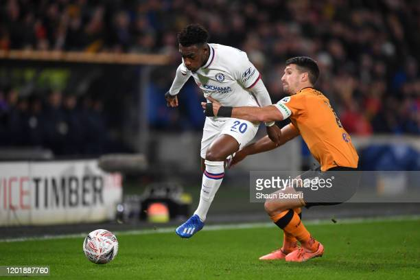 Callum HudsonOdoi of Chelsea battles for possession with Eric Lichaj of Hull City during the FA Cup Fourth Round match between Hull City FC and...
