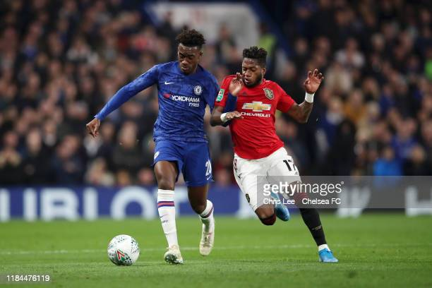 Callum HudsonOdoi of Chelsea battles for possession with Fred of Manchester United during the Carabao Cup Round of 16 match between Chelsea and...