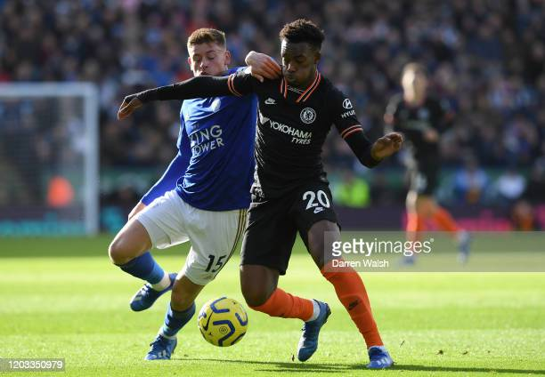 Callum HudsonOdoi of Chelsea battles for possession with Harvey Barnes of Leicester City during the Premier League match between Leicester City and...