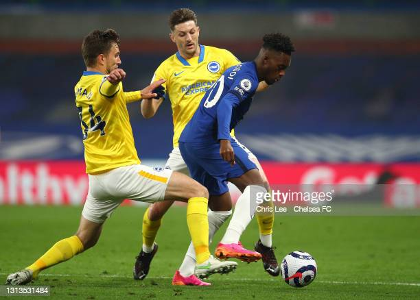 Callum Hudson-Odoi of Chelsea battles for possession with Joel Veltman and Adam Lallana of Brighton & Hove Albion during the Premier League match...