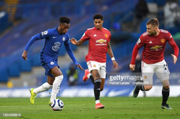 Callum Hudson-Odoi of Chelsea battles for possession with Marcus Rashford and Luke Shaw of Manchester United during the Premier League match between...