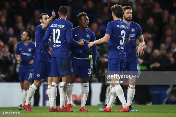 Callum HudsonOdoi of Chelsea celebrates scoring their 3rd goal with team mates during the UEFA Europa League Round of 16 First Leg match between...