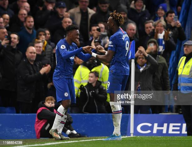 Callum Hudson-Odoi of Chelsea celebrates with teammate Tammy Abraham of Chelsea after scoring his team's third goal during the Premier League match...
