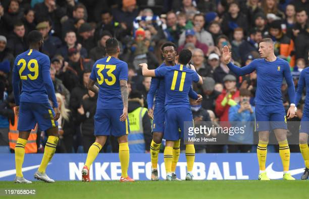Callum HudsonOdoi of Chelsea celebrates with teammates after scoring his team's first goal during the FA Cup Third Round match between Chelsea and...