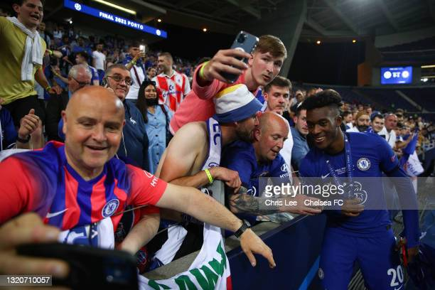 Callum Hudson-Odoi of Chelsea celebrates with the fans after winning the UEFA Champions League Final between Manchester City and Chelsea FC at...