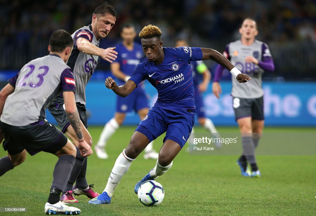 Callum Hudson-Odoi of Chelsea controls the ball against Dino Djulbic and Scott Neville of the Glory during the international friendly between Chelsea FC and Perth Glory at Optus Stadium on July 23, 2018 in Perth, Australia.