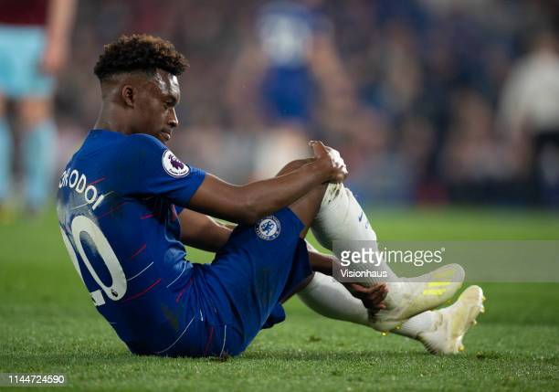 Callum HudsonOdoi of Chelsea feels his right achilles after falling to the ground during the Premier League match between Chelsea FC and Burnley FC...
