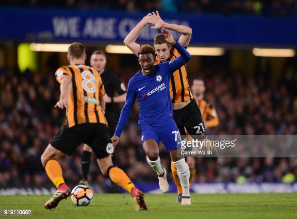 Callum HudsonOdoi of Chelsea gets to the ball ahead of Michael Dawson of Hull City during the Emirates FA Cup Fifth Round match between Chelsea and...