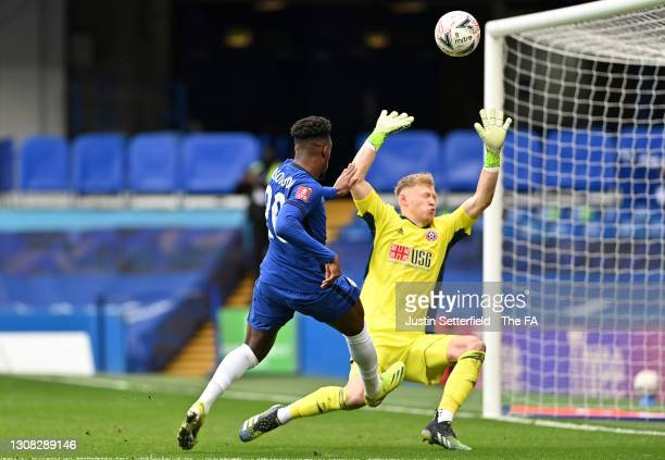 Callum Hudson-Odoi of Chelsea has a shot saved by Aaron Ramsdale of Sheffield United during the Emirates FA Cup Quarter Final between Chelsea and...